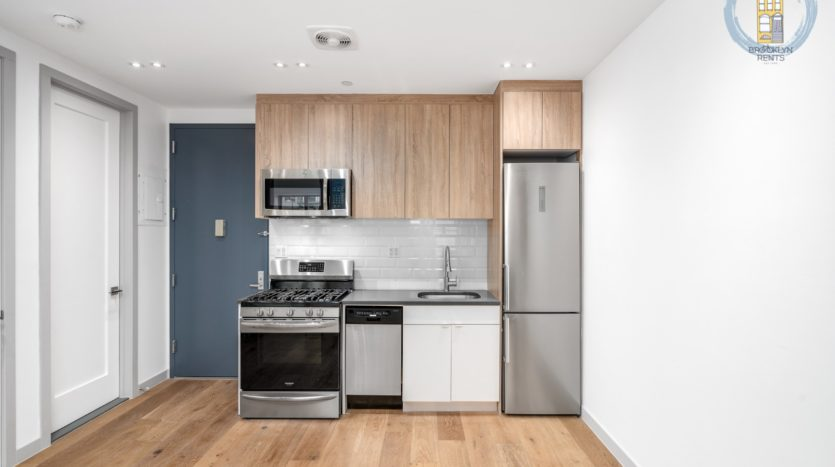 The kitchen has all stainless steel appliances with a fridge, stove, dishwasher, and microwave.