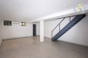 A massive, finished basement space expands the apartment's space greatly.